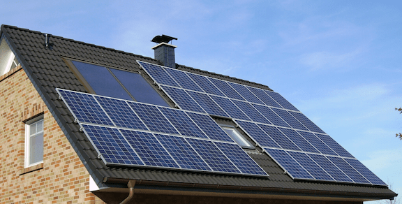 Solar photovoltaic (PV) panels installed on a roof. (Source: WikiMedia Commons)