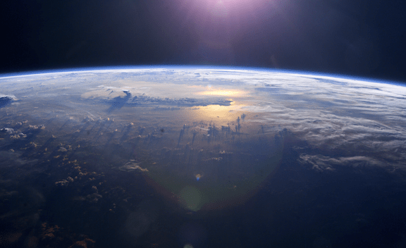 View of Earth's horizon as the sun sets over the Pacific Ocean, taken by an Expedition 7 crew member onboard the International Space Station. (Image Credit: NASA)