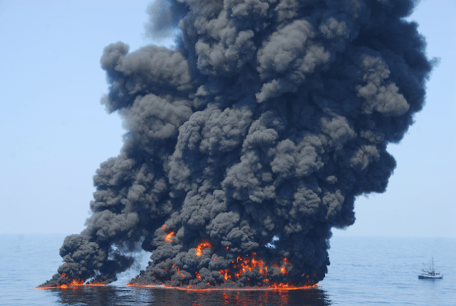 A controlled burn of oil from the Deepwater Horizon/BP oil spill sends towers of fire hundreds of feet into the air over the Gulf of Mexico June 9. (Image Credit: Petty Officer First Class John Masson, Coast Guard / Flickr)