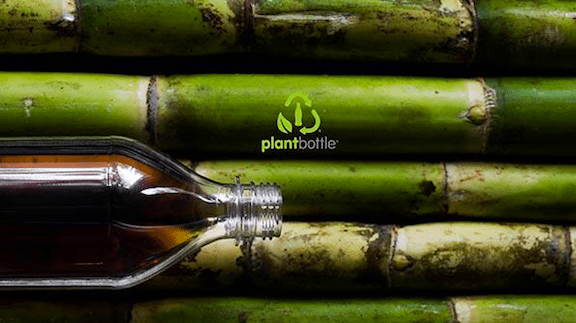 "An ad for Coca-Cola's ""PlantBottle,"" in which the plastic used to make the bottle is switched for eco-friendly sugar cane. (Image via Coca-Cola)"