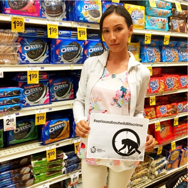 Planet Expert Heather Rally in front of popular cookie products that use palm oil in their ingredients. (Photo courtesy of Heather Rally)