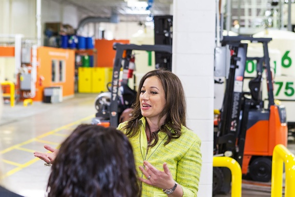 Kelly speaking at the factory. (Photo: EFP)