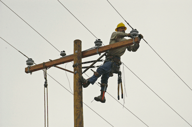 A lineman repairing a damaged power line. (Photo Credit: Marvin Nauman / FEMA)