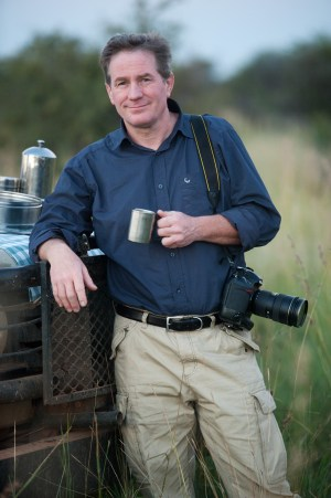 Joel Sartore at a game preserve in South Africa. (Photo courtesy of joelsartore.com)
