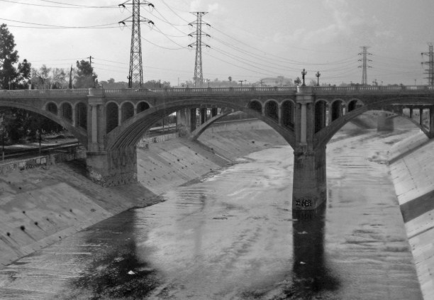 Springtime flow in 2008 at North Broadway-Buena Vista Viaduct (built 1909–11) on the Los Angeles River. (Photo Credit: Downtowngal / WikiMedia Commons)