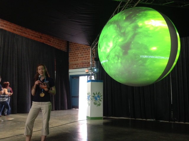 Beth Russell (NOAA) with a real-time projection of the solar surface. (Photo Credit: Pierce Nahigyan)