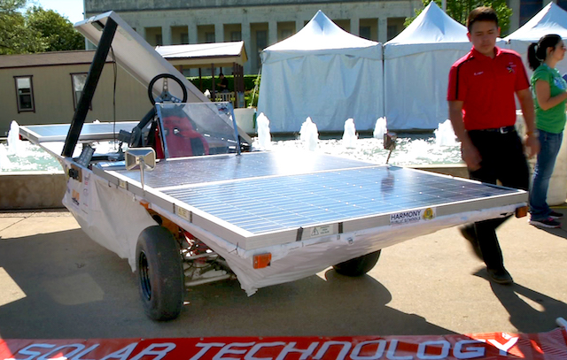 Robert Lopez with solar car. (Photo Credit: Rick Baraff)