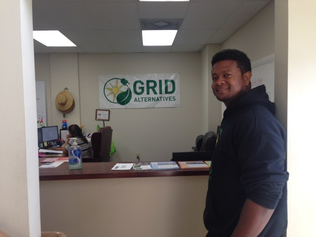 SolarCorps Fellow Nick Boateng gives a tour of the Los Angeles GRID Alternatives office. (Photo Credit: Cameron Phillips)