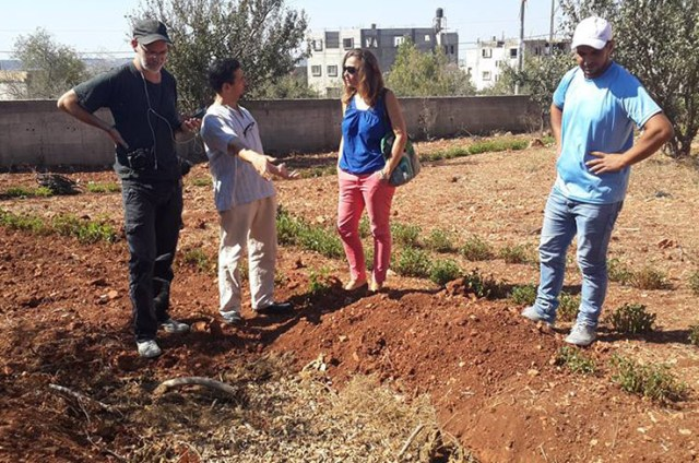 Ecological gardens in Farkha with guests and the agroecology coordinator. (Photo Credit: Saad Dagher)