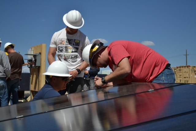 Transitioning veterans at Fort Carson in Colorado receive hands on experience working with solar panels in the base's first Solar Ready Vets cohort. (Photo courtesy of TSF)