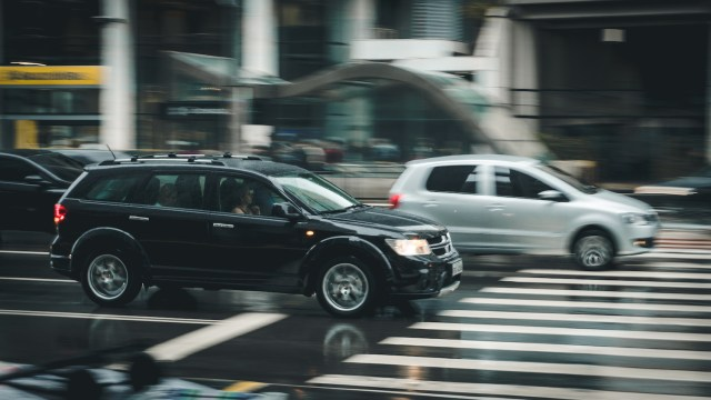 SUV in traffic. (Photo Credit: Pexels)