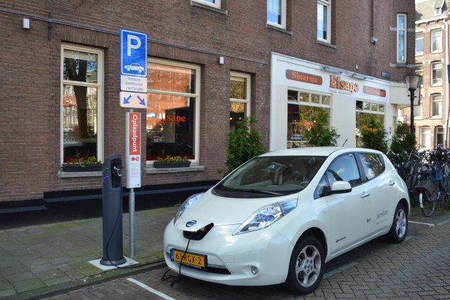 Nissan Leaf recharging at an on-street public station in Amsterdam. (Photo Credit: Bontenbal via WikiMedia Commons)