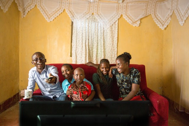 Family watching Azuri TV. (Photo courtesy of Azuri)