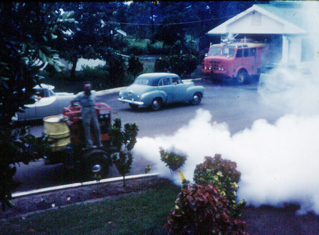 A fogging machine sprays pesticide to kill mosquitos in Australia in 1962. (Photo: Ken Hodge / Flickr)