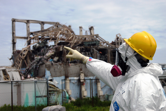 An International Atomic Energy Association worker examines the damage to Reactor Unit 3 at Fukushima Daiichi Nuclear Power Plant in Fukushima prefecture, Japanan. (Photo: Greg Webb / IAEA)