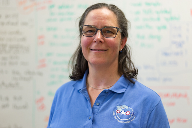 Dr. Annmarie Eldering, the Deputy Project Scientist of the Orbiting Carbon Observatory-2, in her office at JPL. (Photo: Brian Klonoski / Planet Experts)