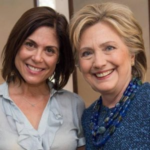 The author with former Secretary of State Hillary Clinton.