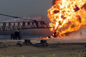 Firefighters fight an oil blaze in Gas-Oil Separation Plant Six as part of their ongoing support of Operation Iraqi Freedom, March 2003. (Photo Credit: LCpl. Dick Kotecki / U.S. Marine Corps)