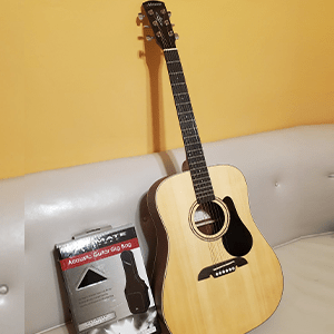 A signed Alverez acoustic guitar Signed By the Members of HELIX