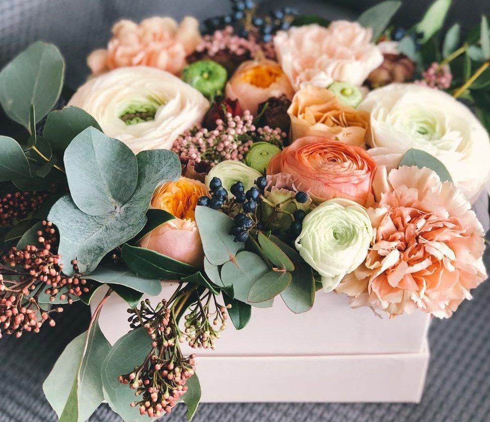 white orange and green floral bouquet decor
