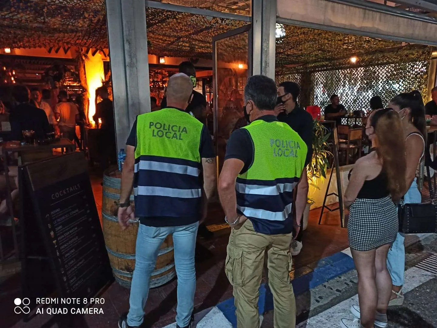 Police inspect a bar in Marbella