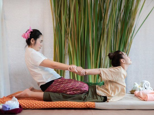 In Thai massage, the client is fully dressed.