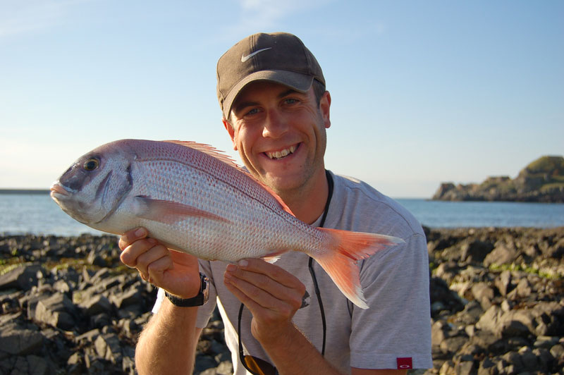 an angler displays a nice Couch's bream
