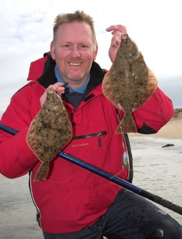 George Bell with two Sandside Bay flounders