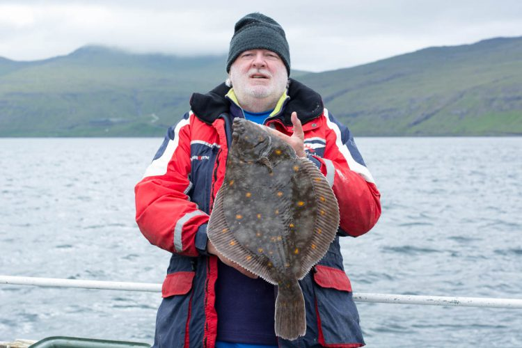 plaice fishing Faroe Islands author with a fish