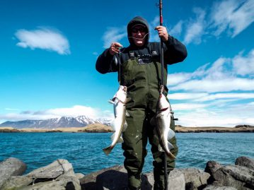 shore fishing Iceland Mark with two cod