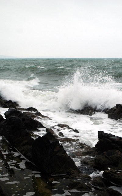 surf pounds the rocks at an Irish bass mark