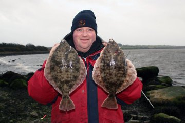 angler holds a double shot of Wexford flounders