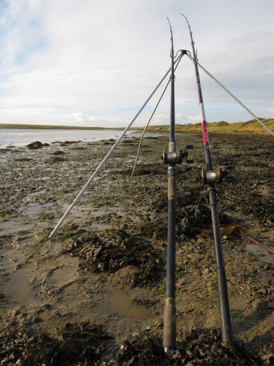 two rods on a tripod waiting for bites
