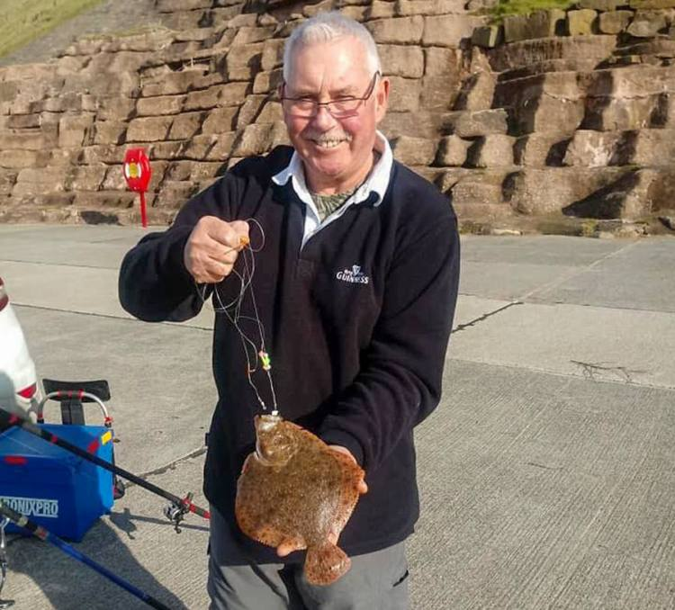 David Wilson with a turbot caught from the Wall