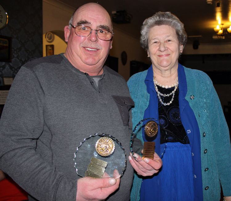 Dave Burr receiving one of his trophies from Christine Faithful