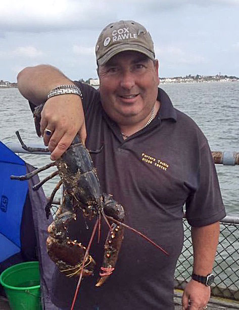 Phil Buy with a large lobster caught from Walton pier