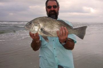 Neil Mackellow with a shore caught fish abroad
