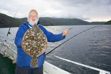 plaice fishing Faroe Islands David with a well marked fish