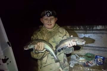 Nine year old Luke Curedon with a brace of codling