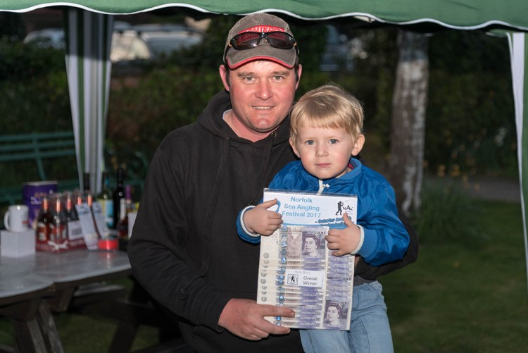 Winner Andy Bunn with son
