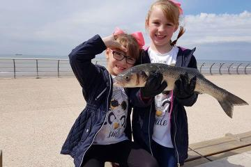 Millie and Evie-Grace with the largest bass