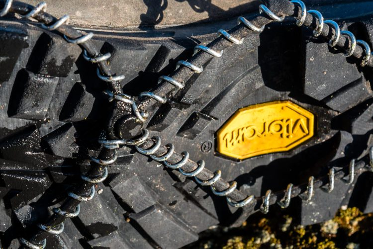 Yaktrax Pro fitted to show raise button outwards