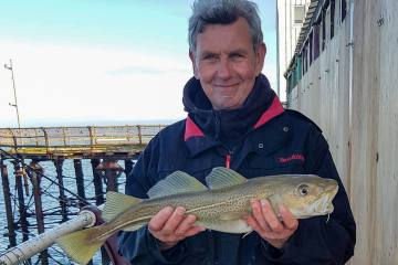 Paul Stanford with a North pier codling