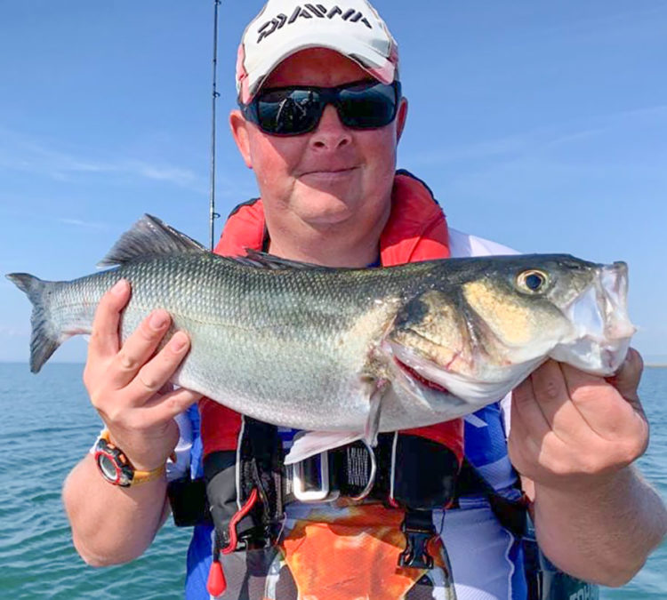 Mark Yule with a bass
