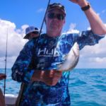 Dana with a yellowtail snapper
