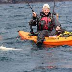 Adam Cain with a nice kayak cod