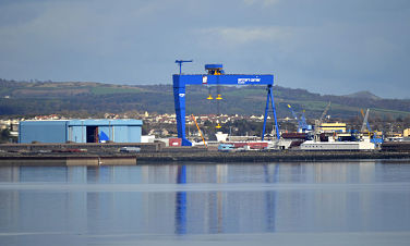 Water in foreground, Rosyth blue ship crane in middle