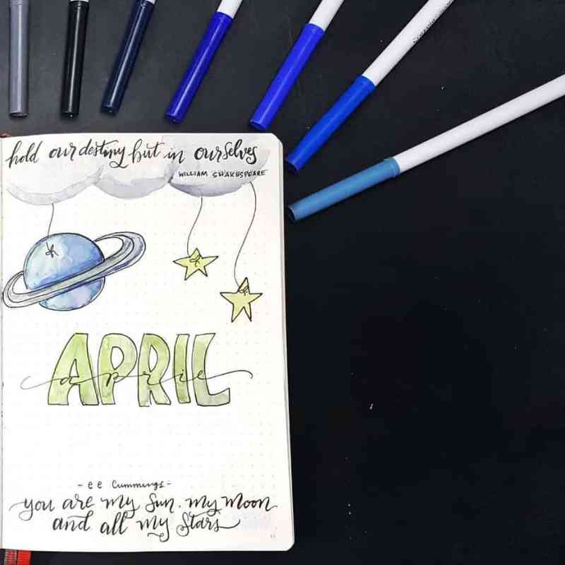 @chocmusings made this great space cover page I love this easy-to-replicate April cover page featuring a pretty space theme. It's not cluttered but includes a few great quotes and intriguing lettering. #bulletjournal