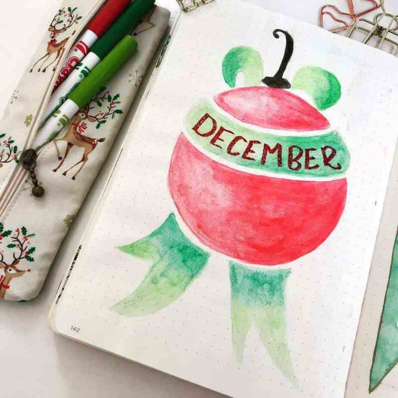 Another take on the ornament theme by @amazinglymarvelous Love this subtle coloring on the ornaments for this bullet journal cover page.