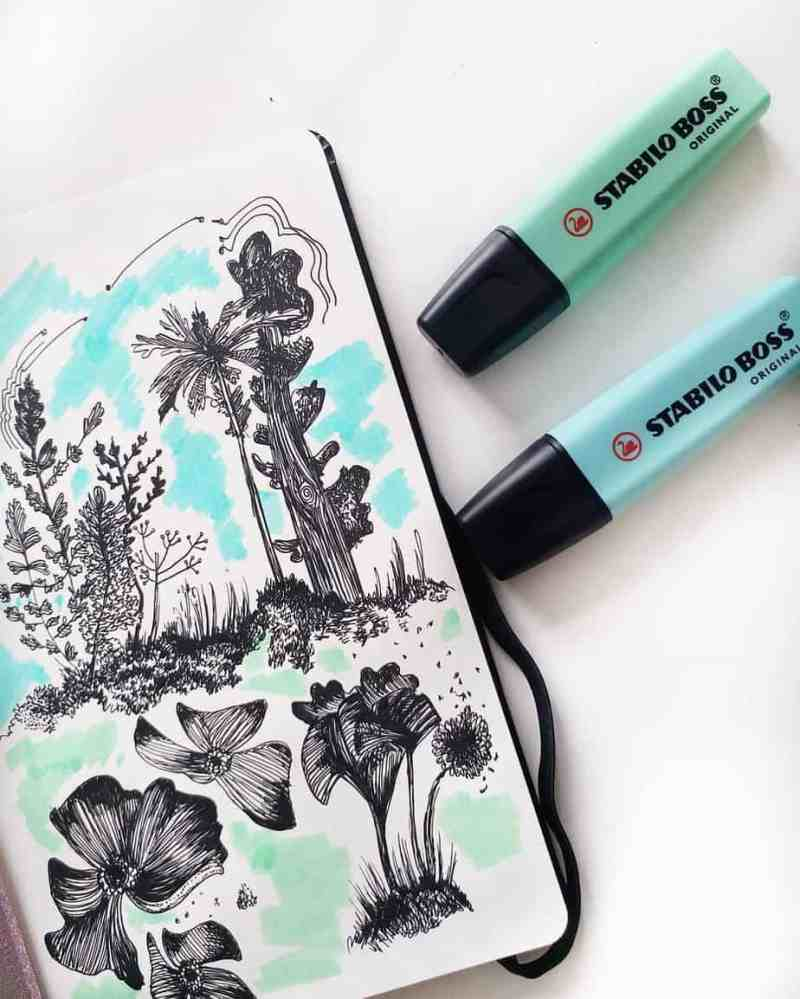 @kosoriibujo created this stunning drawing You can truly see how outdoor settings are a popular theme idea for bullet journal spreads. I love how while this spread has intricate flower drawings, there are also some simplified splashes of color around the drawings.